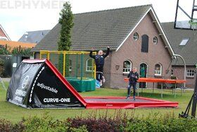 12 Springs Curve-One trampoline inground 585 x 250 cm rood/zwart